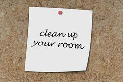 Clean up your room written on a memo Stock Photos