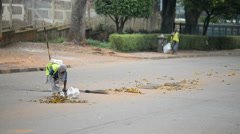 Unidentified local woman doing cleaning street, Kampala, Uganda Stock Footage