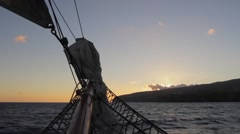 Sunset view looking to La Gomera island from a tall ship at sea in the Canaries - stock footage