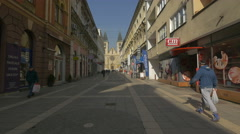Walking on Strossmayerova, close to the Sacred Heart Cathedral, Sarajevo Stock Footage