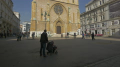 People walking in front of the Sacred Heart Cathedral in Sarajevo Stock Footage