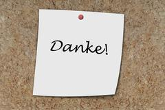 Danke written on a memo Stock Photos