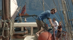 Lone crew member on a tall ship working on deck. Stock Footage