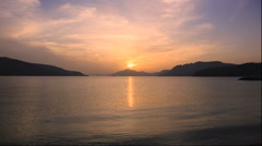 Sunset in the Seto Inland Sea from Hakatajima in Ehime Prefecture - stock footage