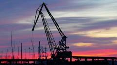 Winter sunset and crane in the port. Stock Footage