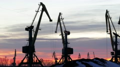 Time lapse beautiful sunset and working cranes . Stock Footage