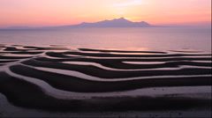 Sunset over mudflat on the Okoshiki Coast of Ariake Sea, Kumamoto Prefecture, Stock Footage