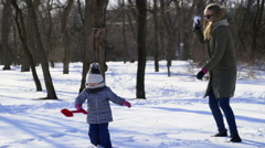 family playing snowballs in the park slow motion - stock footage