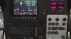 Zoom out shot of the machine controller Stock Footage