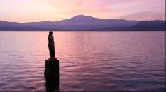 Morning view of Lake Tazawa and Statue of Tatsuko, Akita Prefecture, Japan Stock Footage