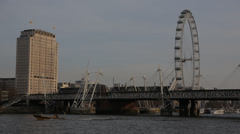 Wide Millennium Wheel with boats going by Stock Footage