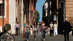 People walk by the pedestrian street in Ravenna, Italy. - stock footage