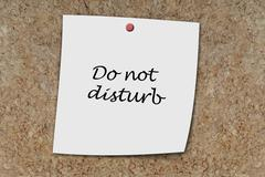Do not disturb written on a memo Stock Photos