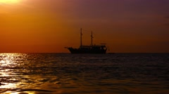 Sailing Yacht Silhouetted against the Tropical Horizon at Sunset. Video 4k Stock Footage