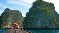 Cruising amongst Limestone Formations on a Longtail Boat in Thailand Stock Footage
