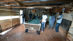 A young men playing billiards in the hut in the Jinja, Uganda. Stock Footage