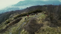The competition between two athletes on the top of the hill Stock Footage