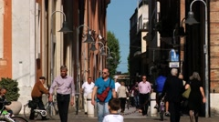 People walk by the pedestrian street in Ravenna, Italy. Stock Footage