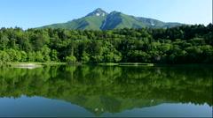 Hime pond and Mount Rishiri, Rishiri Island, Hokkaido, Japan Stock Footage