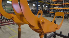 Stock Video Footage of An orange claws of an equipment in the steel factory