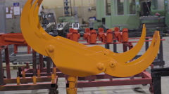 Stock Video Footage of Two orange claws of the machine equipment