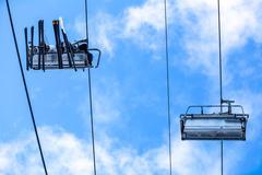 Bottom view ski family on chair lift - stock photo