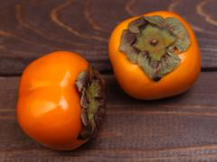 two sweet persimmons - stock photo