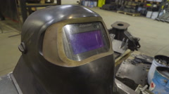 Closer look of the welding mask - stock footage