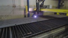The plasma cutter cutting a piece of metal sheet Stock Footage