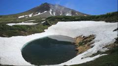 Snow at Suribachi Pond of Daisetsuzan and Mount Asahi, Hokkaido, Japan Stock Footage