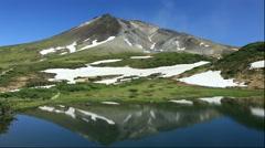 Kagami Pond and Mount Asahi with snow, Hokkaido, Japan Stock Footage