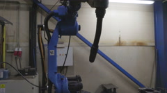 Over the head view of the welding robot inside the room Stock Footage
