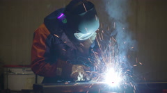 A welder working on the metals and pipes in the factory Stock Footage