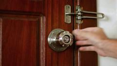 Man's Hand Locking a Wooden Door. Video 4k Stock Footage