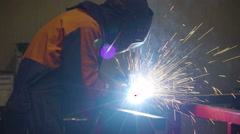 The welder busy on welding the steels and metals Stock Footage