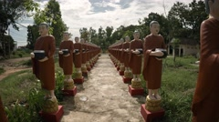 Dozens of Monk Statues Flanking a Walkway at a Buddhist Temple. UltraHD video Stock Footage