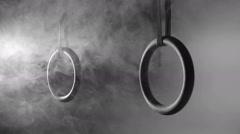 Crossfit rings in smoke Stock Footage