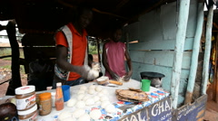 A young man makes chapattis in the Jinja, Uganda. Stock Footage