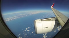 Airliner's Wing and Engine over Cloud Layers at High Altitude. UltraHD video Stock Footage