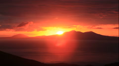 Sunrise behind Kunashir Island seen from the Shiretoko Pass in Hokkaido Stock Footage