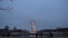 Blurry lights of a ferris wheel reflecting from the ice in Champs Elysee Stock Footage