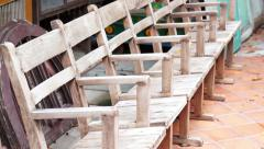 Old wooden chairs in a row. Abstract waiting and time Stock Footage