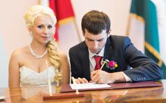 Groom  write on registration of marriage Stock Photos