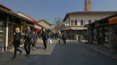 People walking on Gazi Husrev-begova street in Sarajevo Stock Footage