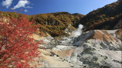 Autumn leaves and Jigokudani at Noboribetsu Onsen in Hokkaido Stock Footage