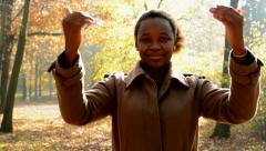 A young beautiful african girl stands in the woods, smilesto camera  Stock Footage