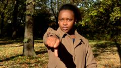 Young beautiful angry african girl stands in the woods, shakes one´s head  Stock Footage