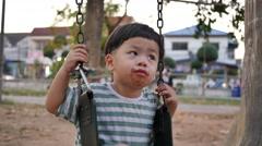 4K, Cute child on swing in park, Stock Footage