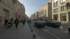 People walking and cars driving on Maršala Tita street in Sarajevo Stock Footage