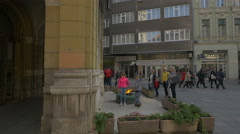 Children standing near a fire pit on Maršala Tita street in Sarajevo Stock Footage